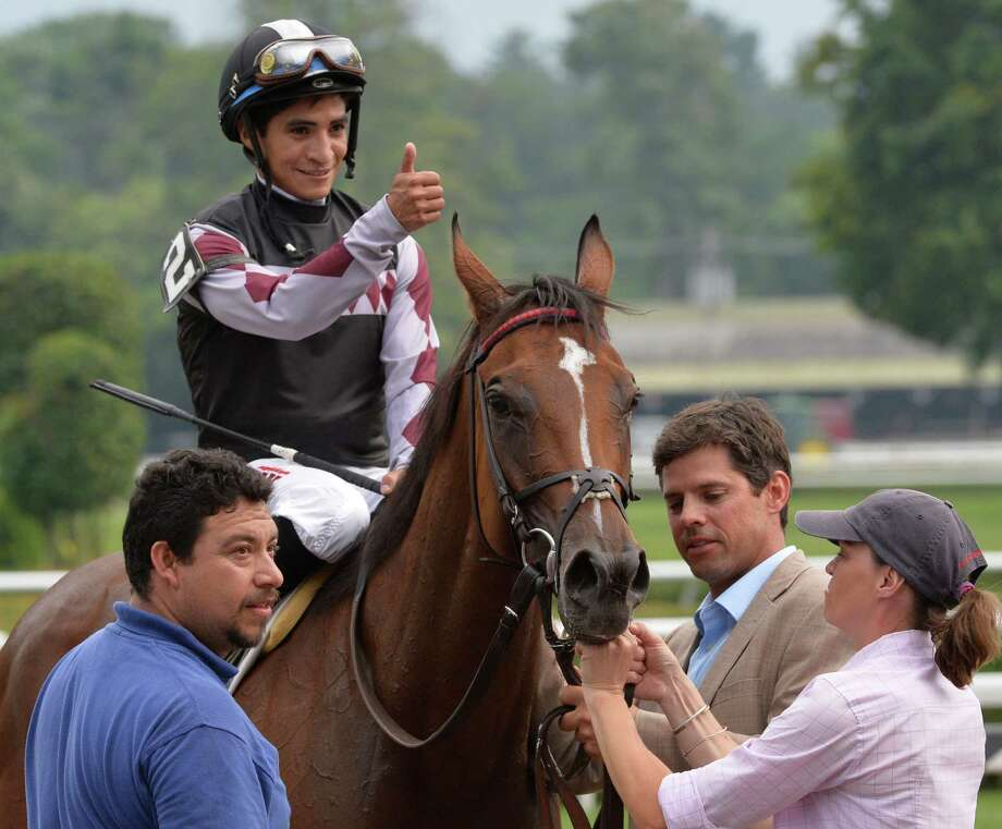 Jockey Alan Garcia gives the thumbs-up as he sits atop Daring Dancer after winning 19th running of The Lake George Wednesday afternoon, July 23, 2014 at Saratoga Race Course in Saratoga Springs, N.Y. (Skip Dickstein / Times Union) Photo: SKIP DICKSTEIN