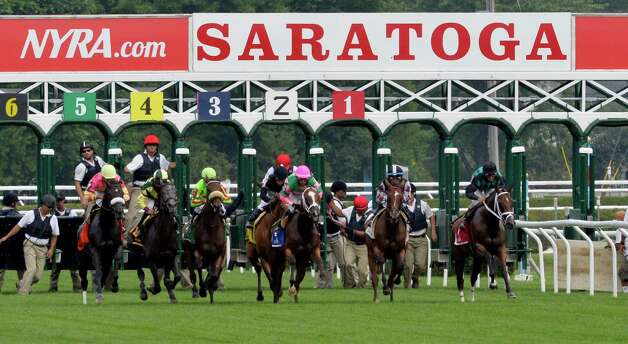 The field leaves the starting gate for the 19th running of The Lake George on Wednesday, July 23, 2014, at Saratoga Race Course in Saratoga Springs.  Photo: SKIP DICKSTEIN