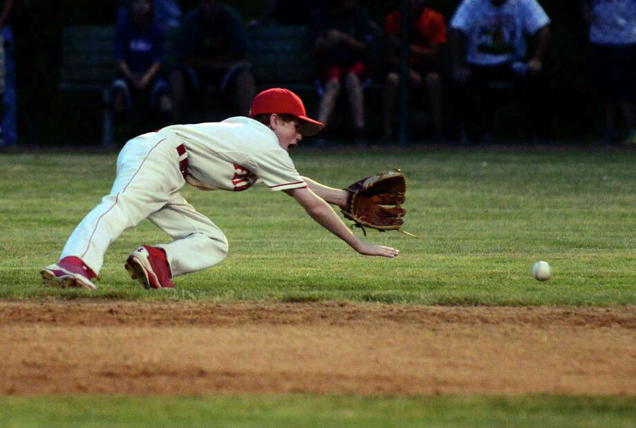 Fairfield American second baseman Brian Kiremidjian can't reach a grounder sent his way, during little league sectional tournament action against Farmington at Old Tavern Park in Orange, Conn. on Wednesday July 23, 2014. Photo: Christian Abraham / Connecticut Post