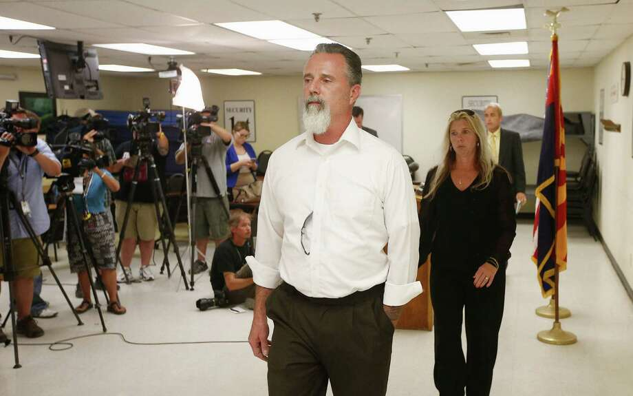 Richard Brown and his wife, Jeanne, leave after speaking during a news conference following the execution of Joseph Rudolph Wood at the Arizona state prison on Wednesday. Photo: Associated Press / AP