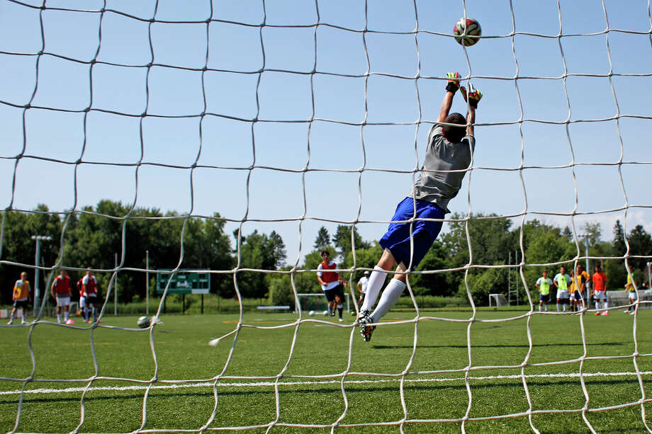 spencer keilen yu of shaker high school makes a save during an athletics camp hosted
