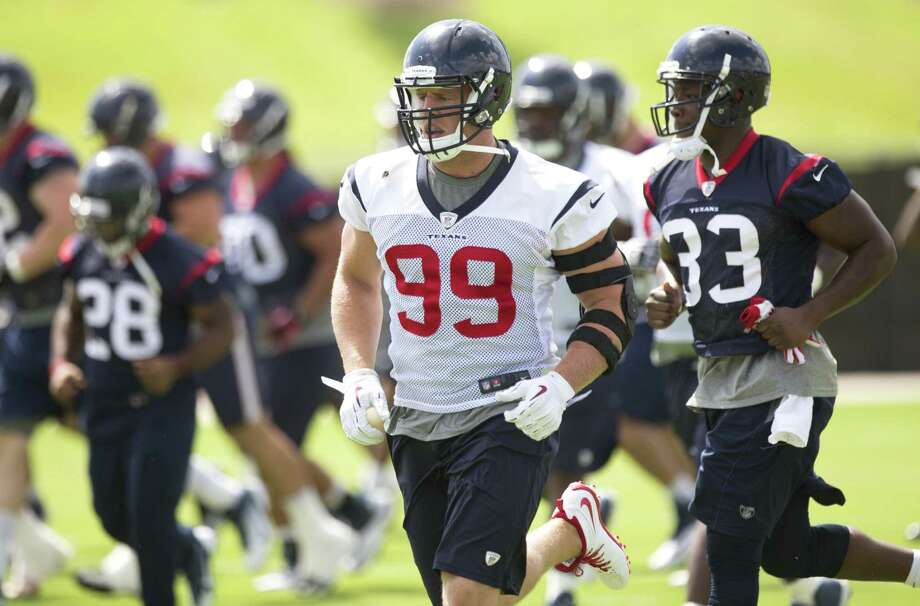 Defensive end J.J. Watt, the NFL defensive player of the year in 2012, will need a similar performance this season for the Texans to contend for a playoff spot after a 2-14 record last year. Photo: Brett Coomer / Houston Chronicle / © 2014 Houston Chronicle