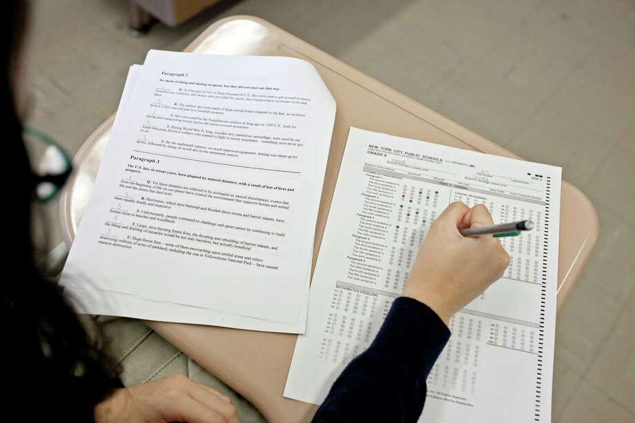 Kassidi Cheng, 12, in one of her test-prep classes that cost her mother $2,000, at Bishop Kearney High School, in New York, Oct. 13, 2012. The disparity in performance of various racial groups on the test for admission to New York City's elite public high schools has prompted calls for an end to the policy of using the test as the sole basis for admission. (Michael Kirby Smith/The New York Times) Photo: MICHAEL KIRBY SMITH / NYTNS