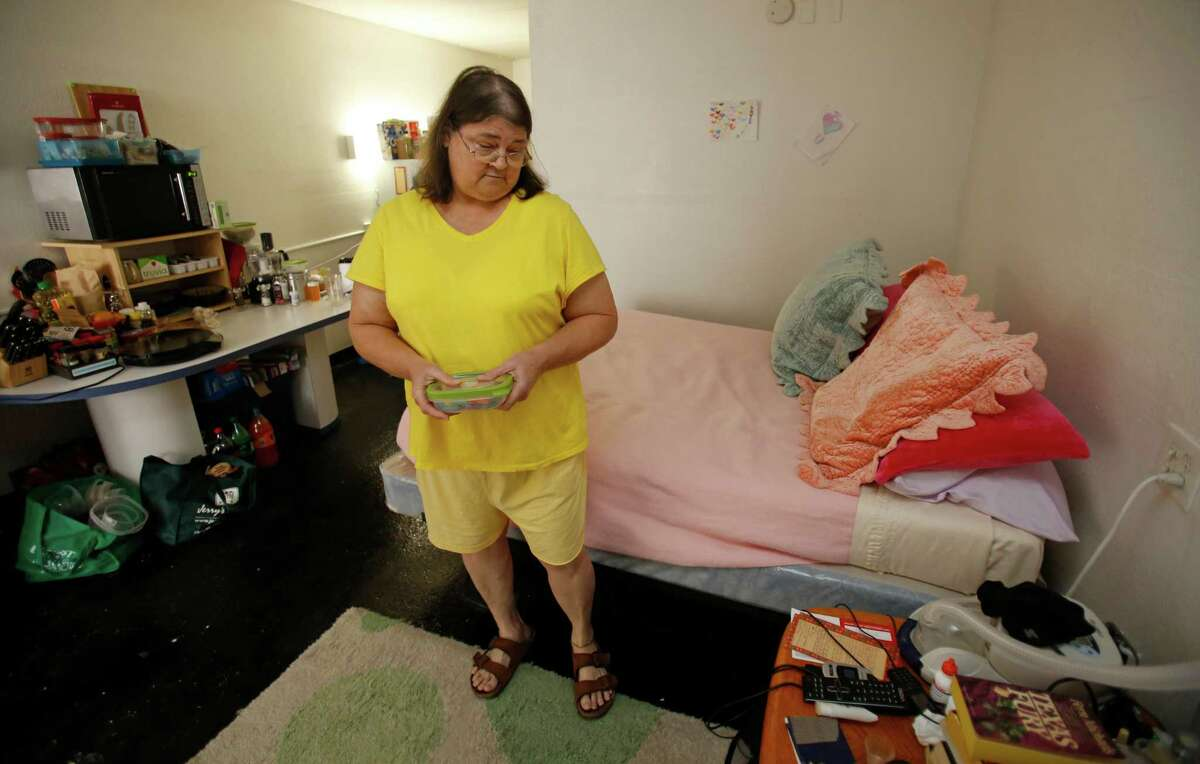 Kathi Faith talks about her single resident occupancy apartment where she has lived for two years at Northline SRO, 3939 North Freeway, Monday, July 21, 2014, in Houston.