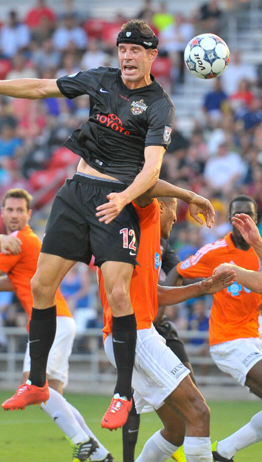 Scorpions Greg Janicki heads the ball versus the Carolina defense during their North American Soccer League match at Toyota Field Wednesday. Photo: Robin Jerstad