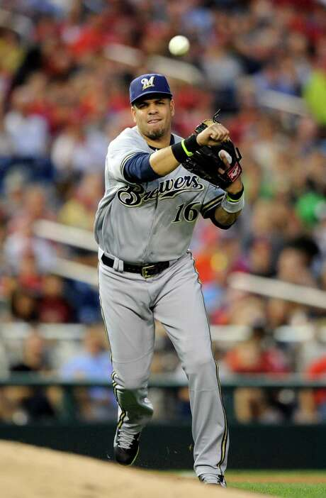 Milwaukee Brewers third baseman Aramis Ramirez throws to first for the out on Washington Nationals' Tanner Roark during the third inning of a baseball game, Saturday, July 19, 2014, in Washington. (AP Photo/Nick Wass) Photo: Nick Wass, FRE / FR67404 AP