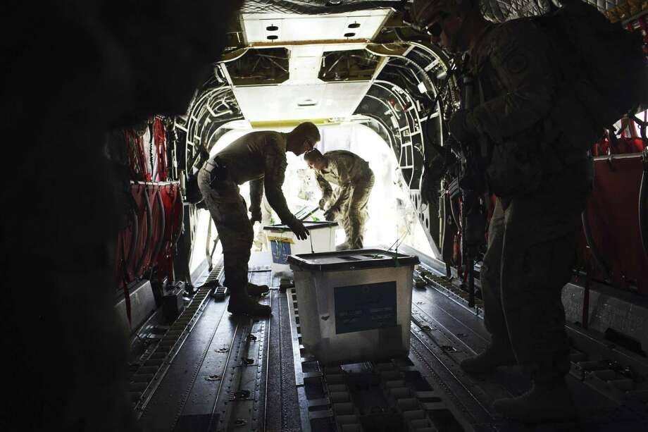 Some of the hundreds of ballot boxes collected from Afghanistan's Paktia province and destined for Kabul are loaded onto a helicopter in Gardez. Photo: Andrew Quilty / New York Times / NYTNS