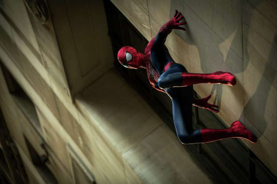 "In this publicity photo released by Sony Pictures Entertainment, Andrew Garfield stars as Spider-Man in Columbia Pictures' ""The Amazing Spider-Man 2."" The Spider-Man franchise will detour next with a ""Sinister Six"" spinoff in 2016, pushing ""The Amazing Spider-Man 3"" to 2018. Sony's Columbia Pictures announced its updated schedule for the web-slinger Wednesday, July 23, 2014. By ordering ""Sinister Six"" ahead of the next ""Spider-Man"" movie, the studio hopes to expand the franchise with the group of Marvel super villains. Sony had previously pegged ""Spider-Man"" sequels for 2016 and 2018, but ""The Amazing Spider-Man 3"" will now be pushed to 2018. (AP Photo/Sony Pictures Entertainment, Niko Tavernise) ORG XMIT: NYET316 Photo: Niko Tavernise / Sony Pictures Entertainment"