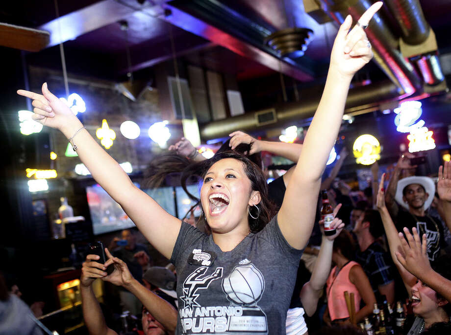 Fans celebrate at The Ticket as the Spurs win the NBA title. The pub was one spot that saw an increase in alcohol sales in May and June. Photo: San Antonio Express-News File Photo / SAN ANTONIO EXPRESS-NEWS