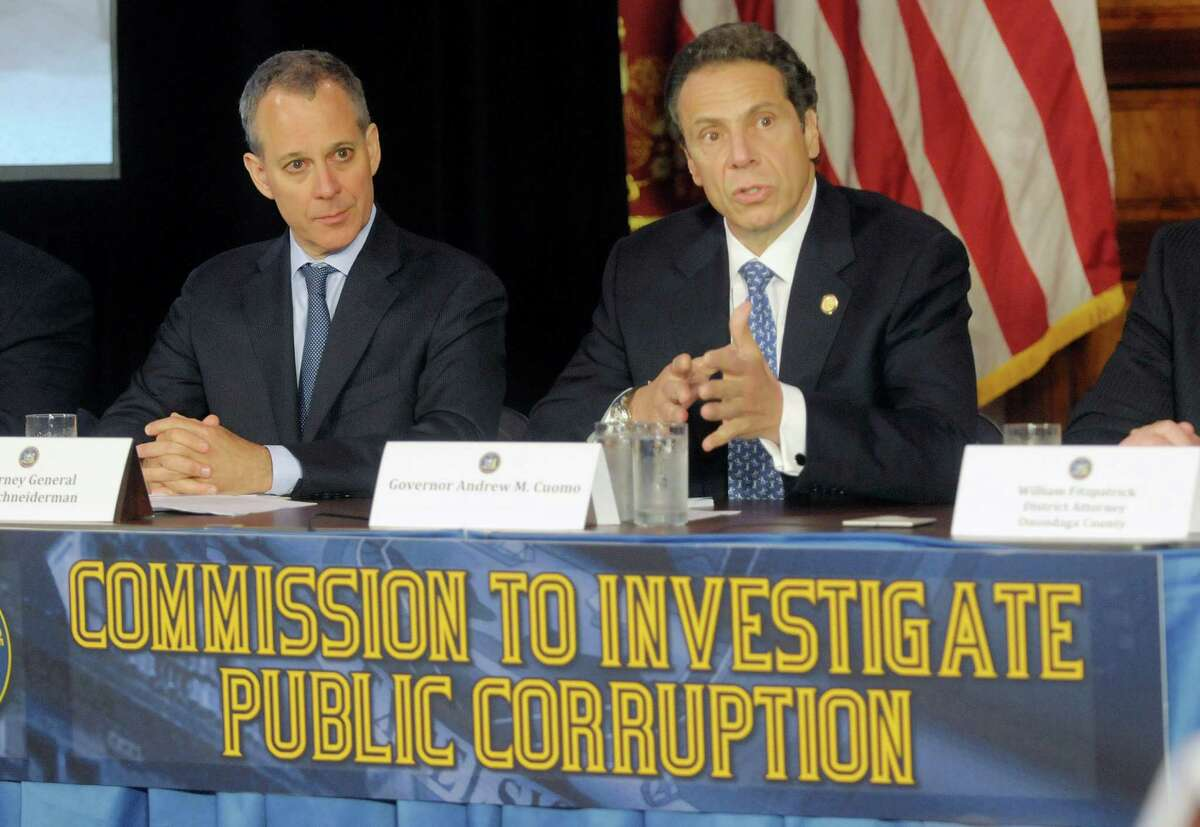 New York State Attorney General Eric Schneiderman, left, and Governor Andrew Cuomo take part in press conference at the Capitol on Tuesday, July 2, 2013, where Governor Cuomo introduced the members of the Moreland Commission that will investigate public corruption around the state. (Paul Buckowski / Times Union archive)