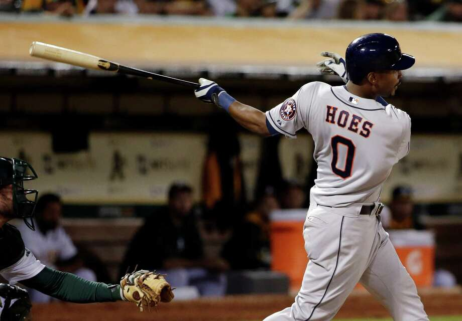 L.J. Hoes connects for the game-winning home run in the 12th inning Tuesday. Photo: STF / AP