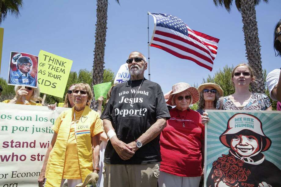 The Rev. Anne Hines (left) and others gather at a naval base in Port Hueneme, Calif., in support of immigrant children. Photo: Monica Almeida / New York Times / NYTNS