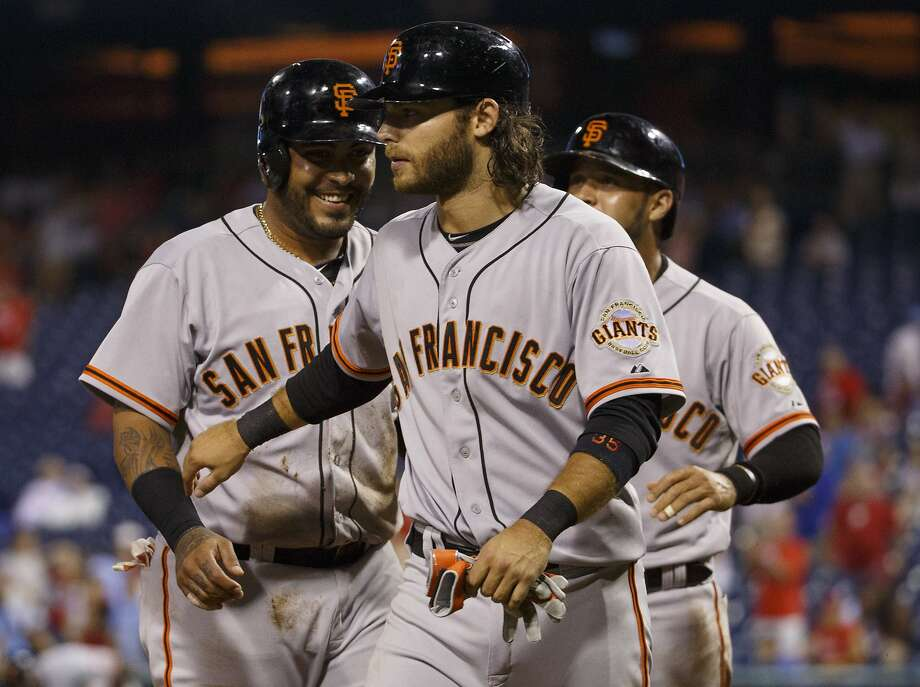 Hector Sanchez (left), Brandon Crawford and Gregor Blanco had a party at the plate after Hunter Pence drove them in. Photo: Chris Szagola, Associated Press
