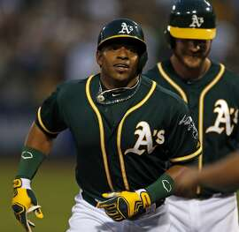 Oakland Athletics' Yoenis Cespedes heads to the dugout after his 2-run home run in the 4th inning, his second of the game off of Houston Astros' Brad Peacock, during MLB game at O.co Coliseum in Oakland, Calif. on Wednesday, July 23, 2014.