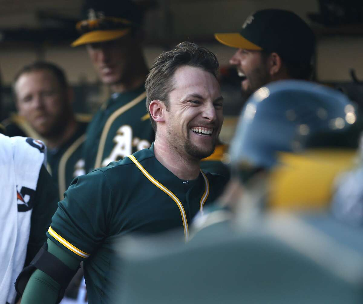 Oakland Athletics' Jed Lowrie celebrates his solo home run off of Houston Astros' Brad Peacock in 2nd inning during MLB game at O.co Coliseum in Oakland, Calif. on Wednesday, July 23, 2014.
