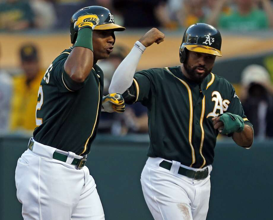 Yoenis Céspedes celebrates his three-run homer with Coco Crisp in the second. Photo: Scott Strazzante, The Chronicle