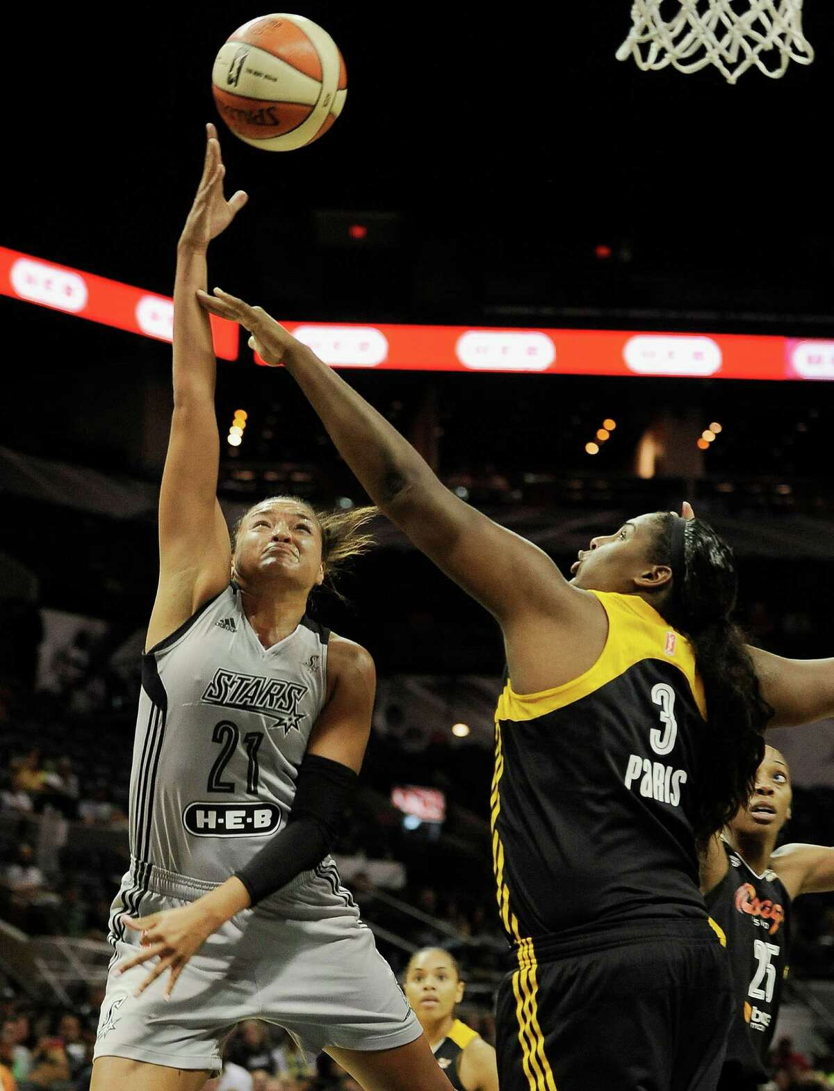 San Antonio Stars' Kayla McBride, left, shoots against Tulsa Shock's Courtney Paris during the first half of a WNBA basketball game, Tuesday, July 22, 2014, in San Antonio. (Darren Abate/For the Express-News)