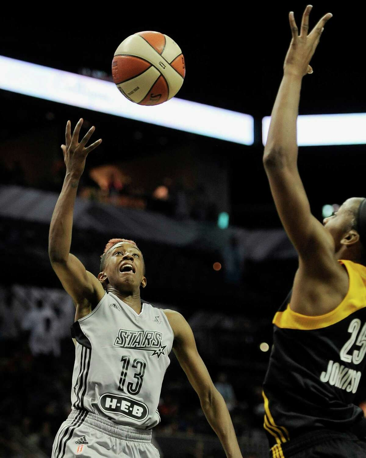San Antonio Stars' Danielle Robinson, left, shoots the go-ahead basket over Tulsa Shock's Glory Johnson with 3.5 seconds left in a WNBA basketball game, Tuesday, July 22, 2014, in San Antonio. San Antonio won 95-93. (Darren Abate/For the Express-News)