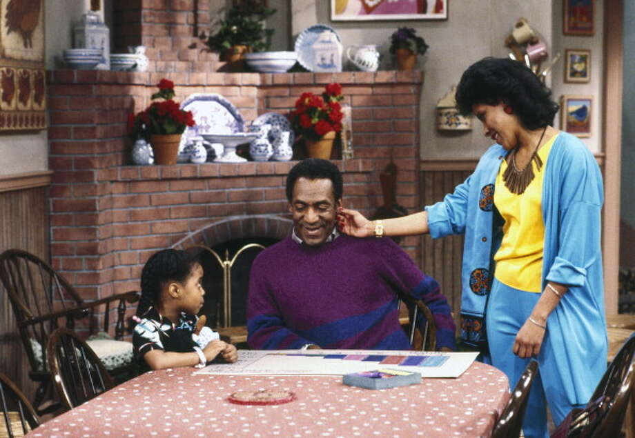 "THE COSBY SHOW -- Pictured: ""Mr. Quiet"" Episode 23 (l-r) Keshia Knight Pulliam as Rudy Huxtable, Bill Cosby as Dr. Heathcliff 'Cliff' Huxtable, Phylicia Rashad as Clair Hanks Huxtable (Photo by Alan Singer/NBC/NBCU Photo Bank via Getty Images) THE COSBY SHOW -- Pictured: ""Mr. Quiet"" Episode 23 (l-r) Keshia Knight Pulliam as Rudy Huxtable, Bill Cosby as Dr. Heathcliff 'Cliff' Huxtable, Phylicia Rashad as Clair Hanks Huxtable  (Photo by Alan Singer/NBC/NBCU Photo Bank via Getty Images)   For editorial use only. Additional clearance required for commercial or promotional use, contact your local office for assistance. Any commercial or promotional use of NBCUniversal content requires NBCUniversalís prior written consent. Photo: NBC, Getty Images / Getty Images"