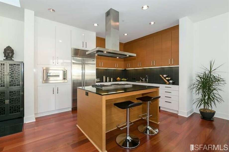 Miele, Viking and Sub-Zero appliances in the kitchen. Photo: MLS