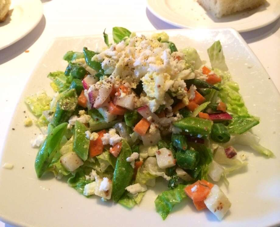The chopped salad with both snap and green beans in a buttermilk dressing was comforting but bland ($12.50).