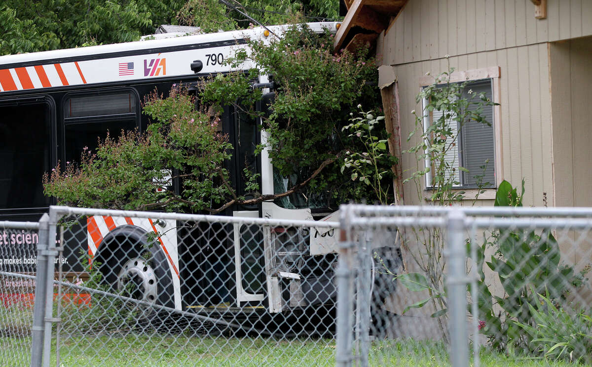A VIA bus crashed into a house Thursday July 24, 2014 on the 2600 block of Ceralvo near Allende street. Police said the bus was headed west on Ceralvo when a car allegedly ran a stop sign causing the bus to hit a fence and veer into a nearby house. A black SUV was also involved in the accident. There were no serious injuries.