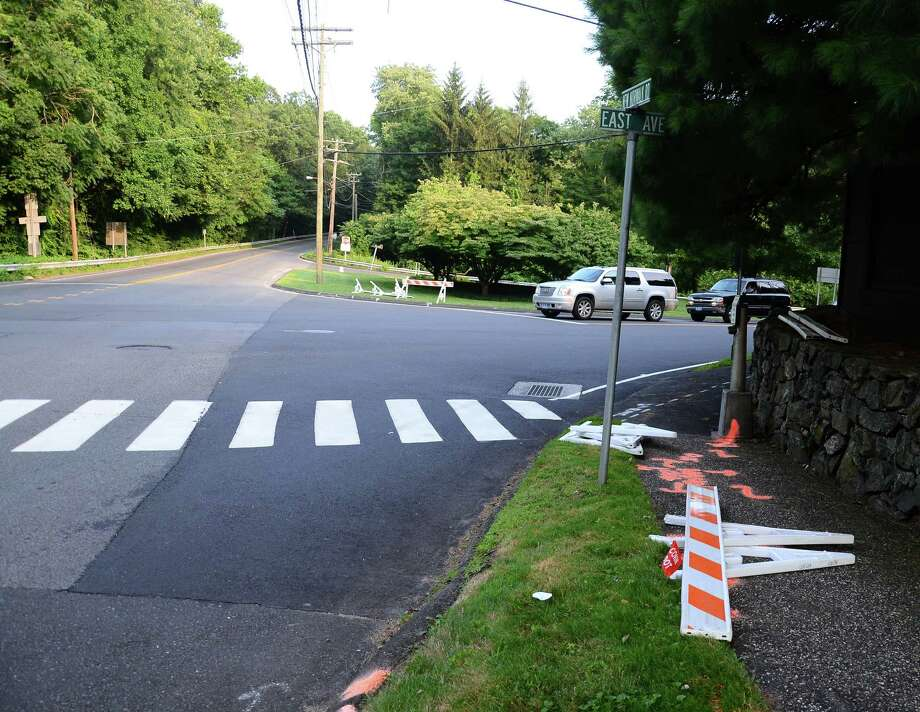 "Benjamin Olmstead, 71, of Norwalk, was struck by a Dodge Ram Wednesday, July 23, 2014, at the intersection of New Norwalk Road, also known as Route 123, and East Avenue in New Canaan, Conn., while spray painting the road. The victim, a veteran of the town's Department of Public Works, suffered ""serious injuries"" and is being treated at Norwalk Hospital, according to police. Photo: Nelson Oliveira / New Canaan News"