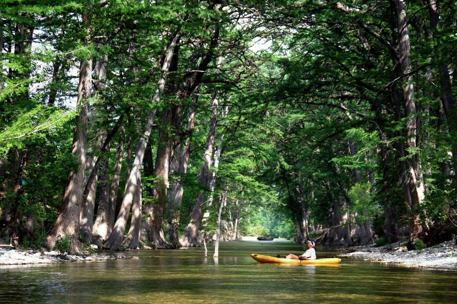 1. Kayak the Medina River -- Cypress trees shade the Medina River below to make for a cool summer day. Running right through Bandera, the Medina River is a great place for kayaking and tubing, as it doesn't get the crowds of river rats that Guadalupe River sees. Photo: William Luther, San Antonio Express-News / © 2012 WILLIAM LUTHER