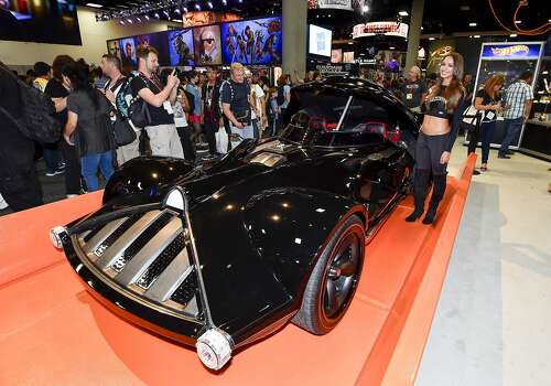 Fans take photos of life sized Hot Wheels Darth Vader Mobile during preview night at the 2014 Comic-Con International Convention held  Wednesday, July 23, 2014 in San Diego.  Photo: Denis Poroy, Associated Press