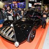 Fans take photos of life sized Hot Wheels Darth Vader Mobile during preview night at the 2014 Comic-Con International Convention held  Wednesday, July 23, 2014 in San Diego.