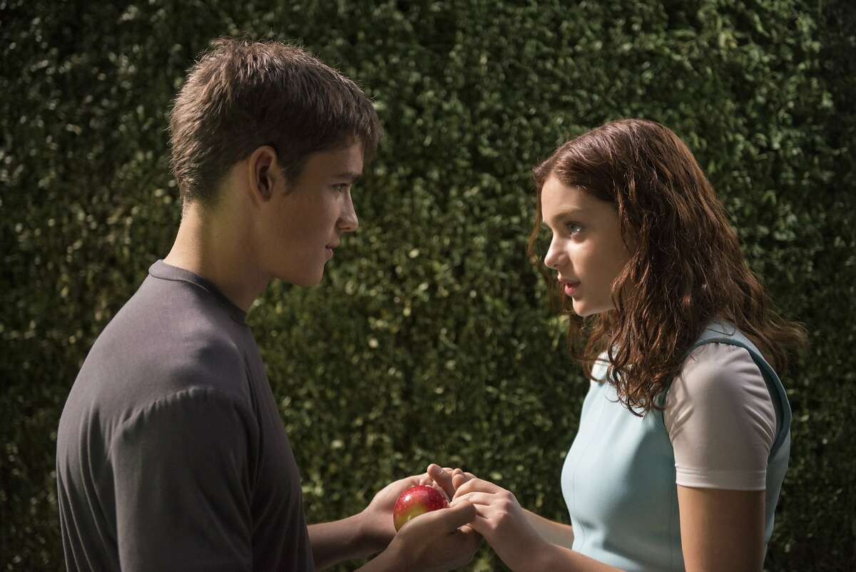 """This photo released by The Weinstein Company shows Brenton Thwaites, left, and Odeya Rush in a scene from the film, """"The Giver."""" (AP Photo/The Weinstein Company, David Bloomer)"""