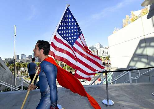 Bersain Gutierrez, dressed as Superman, carries an American flag during preview night at the 2014 Comic-Con International Convention held  Wednesday, July 23, 2014 in San Diego.  Photo: Denis Poroy, Associated Press