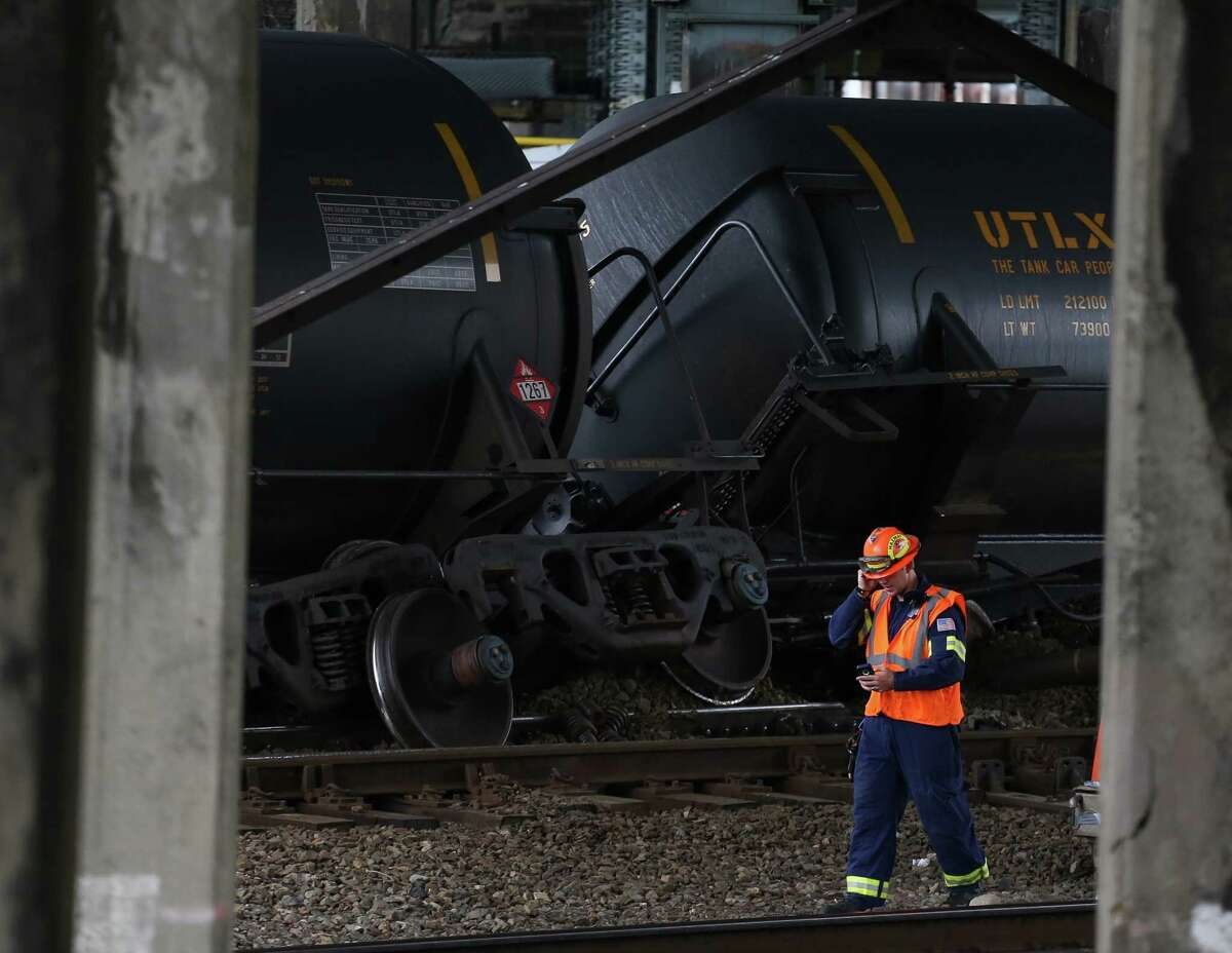 Oil tankers cars are shown after they derailed under the Magnolia Bridge on Thursday, July 24, 2014. The oil, bound for an Anacortes oil refining facility, did not spill in the accident.
