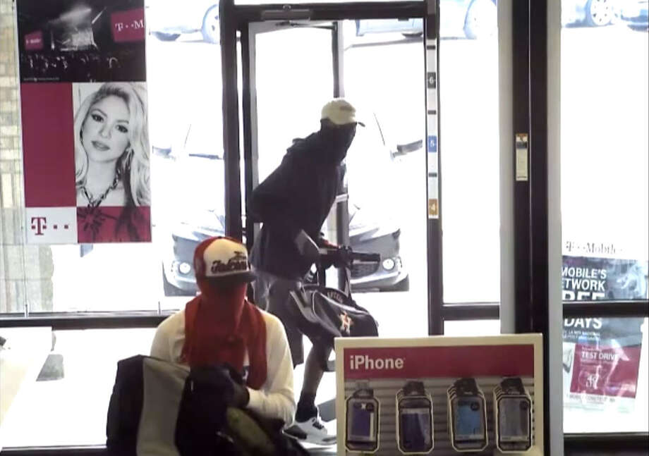 CELLPHONE STORE ROBBERY, PART 2: The Harris County Sheriff's Office is looking for three masked gunmen who robbed a T-Mobile store location at 12260 West FM 1960 by gunpoint on Wednesday, July 23, 2014 and assaulted employees inside. The gunmen made off with 80 cellphones averaging $400 in price each and an unknown amount of money.SEE THE VIDEO: Robbers grab $30,000 in cellphones in NW Harris Co. Photo: Harris County Sheriff's Office