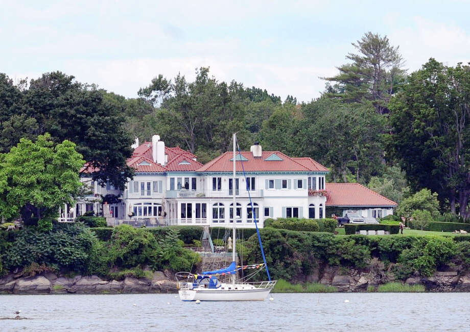 A waterfront home facing Greenwich Cove in the Riverside section of Greenwich, Conn., Thursday, July 24, 2014. Photo: Bob Luckey / Greenwich Time