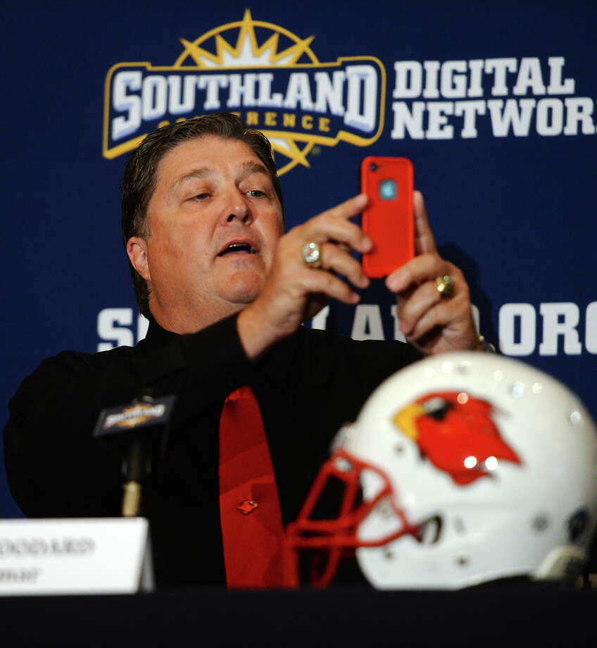 Lamar Head Coach Ray Woodard takes a panorama of the interview room during the Cardinals' turn in the spotlight at the Southland Conference Media Day on Wednesday. Woodard joked that people worried he didn't use social media often enough. The event was held at the L'Auberge Casino and Resort in Lake Charles on Wednesday. Representatives from the conference's 11 teams spoke with media from around the region. Photo taken Wednesday 7/23/14 Jake Daniels/@JakeD_in_SETX Photo: Jake Daniels / ©2014 The Beaumont Enterprise/Jake Daniels