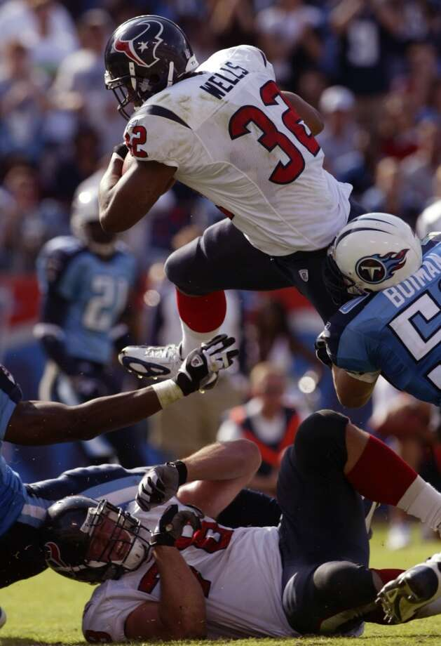 Texans 20, Titans 10 Oct. 17, 2004  The Texans notch their first win in the series as David Carr passes for 266 yards and a touchdown and Jonathan Wells rushes for 73 yards and caps the victory with a late TD. Photo: Andrew Innerarity, Chronicle