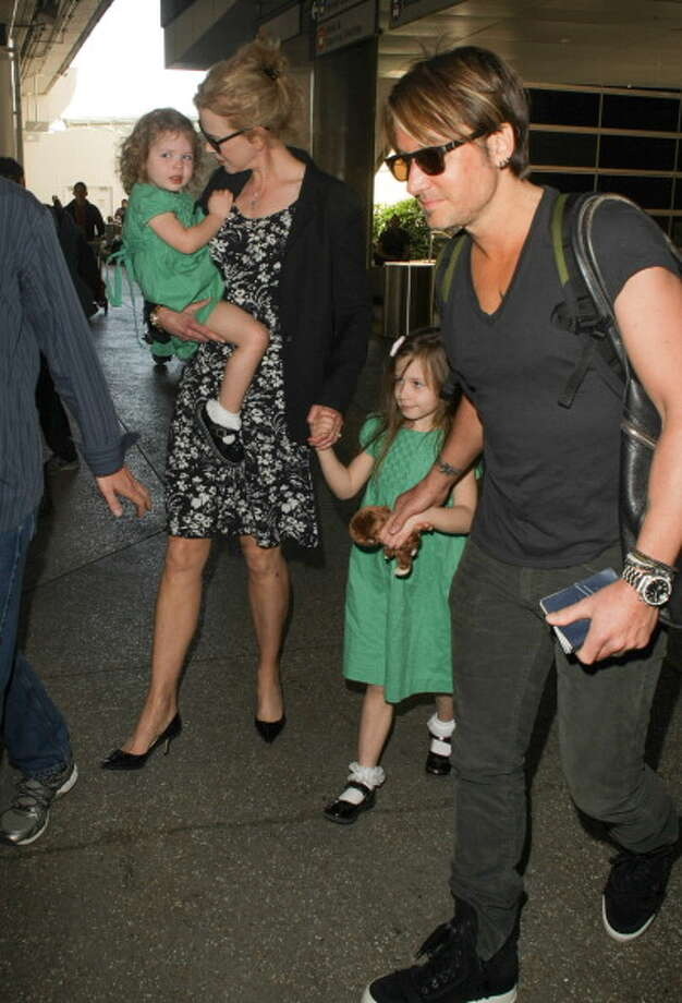 Nicole Kidman and her husband Keith Urban stepping out with their daughters, Sunday Rose and Faith Margaret. Photo: GVK/Bauer-Griffin, Getty Images / 2014 Bauer-Griffin