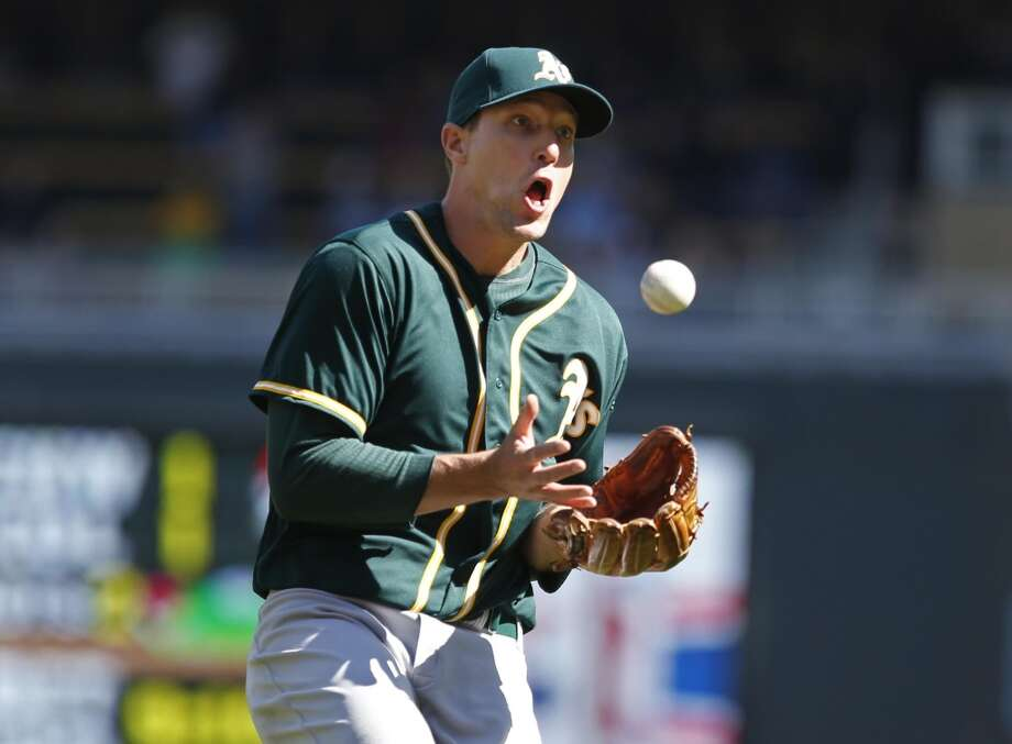 Oakland Athletics relief pitcher Jim Johnson (45) catches a bunt attempt by the Minnesota Twins in the 9th inning at Target Field. Athletics win 7-4 in 11 innings. Photo: Bruce Kluckhohn, Reuters