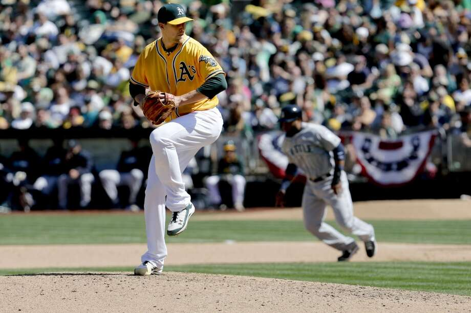 A's  pitcher Jim Johnson, (45) in to throw in the 8th inning, as the Oakland Athletics went on to lose to the Seattle Mariners 3-1 at the O.co Coliseum on Saturday April 5, 2014, in Oakland, Calif. Photo: Michael Macor, The Chronicle