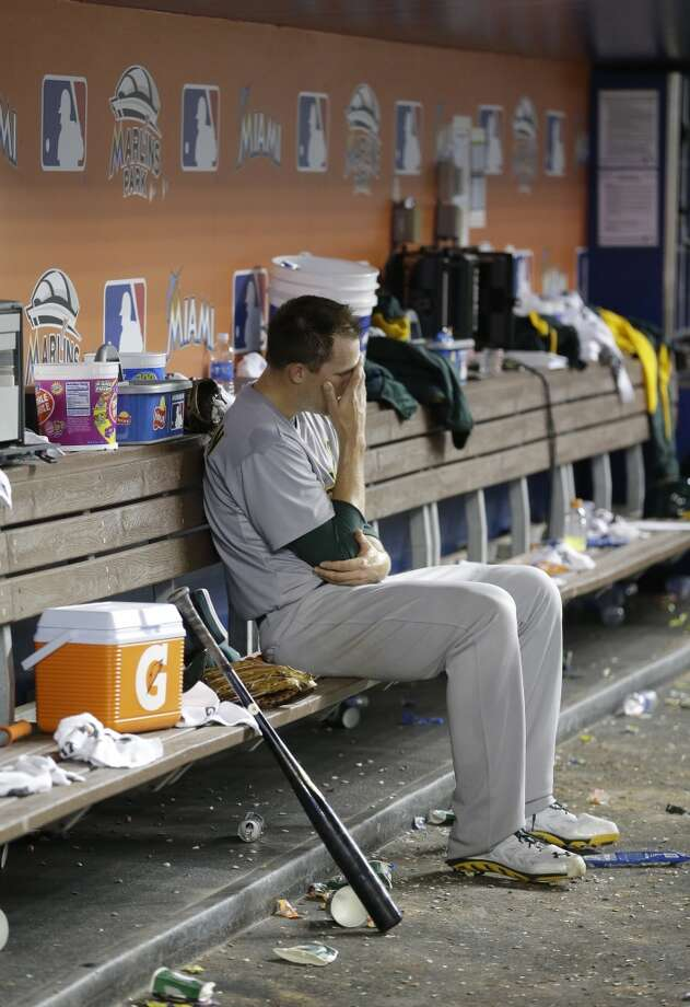 Oakland Athletics relief pitcher Jim Johnson sits on the bench after having been relieved from the mound during the 14th inning of a baseball game against the Miami Marlins, Saturday, June 28, 2014 in Miami. The Athletics beat the Marlins 7-6 in 14 innings. Photo: Wilfredo Lee, Associated Press