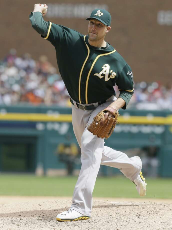 Oakland Athletics relief pitcher Jim Johnson throws during the sixth inning of a baseball game against the Detroit Tigers in Detroit, Wednesday, July 2, 2014. Photo: Carlos Osorio, Associated Press