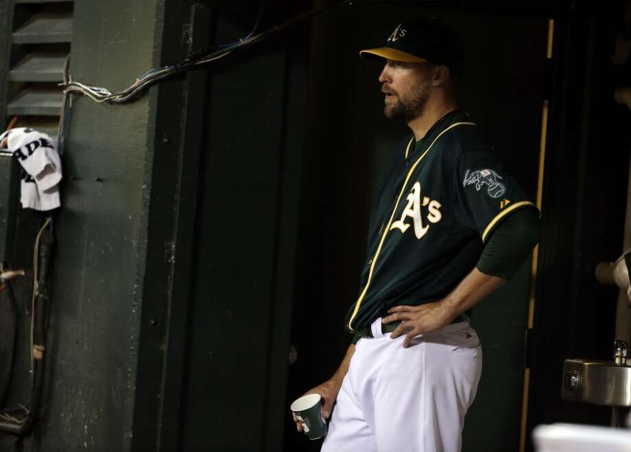 Oakland Athletics reliever Jim Johnson watches from the dugout after being pulled from the game during the eighth inning of a baseball game against the Houston Astros on Wednesday, July 23, 2014, in Oakland, Calif. Photo: Associated Press