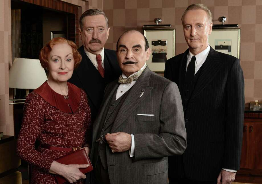"Pauline Moran as Miss Lemon, from left, Philip Jackson as Inspector Japp, David Suchet as Poirot, and Hugh Fraser as Captain Hastings in ""The Big Four."" The story plunges Poirot into a world of global espionage, set against the backdrop of the impending WWII.  With the help of old friends Captain Hastings, Inspector Japp and Miss Lemon, Poirot must navigate international figures and intrigue to identify the culprit."
