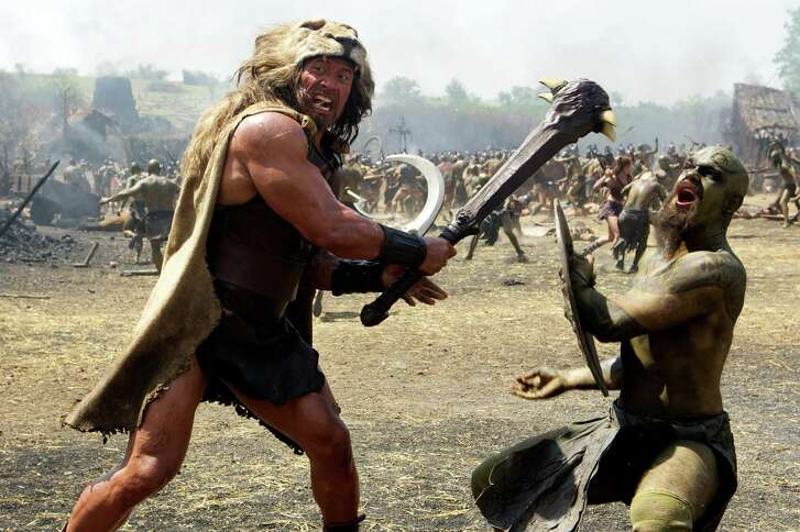 """This image released by Paramount Pictures shows Dwayne Johnson as Hercules in a scene from """"Hercules."""" (AP Photo/Paramount Pictures, Kerry Brown)"""