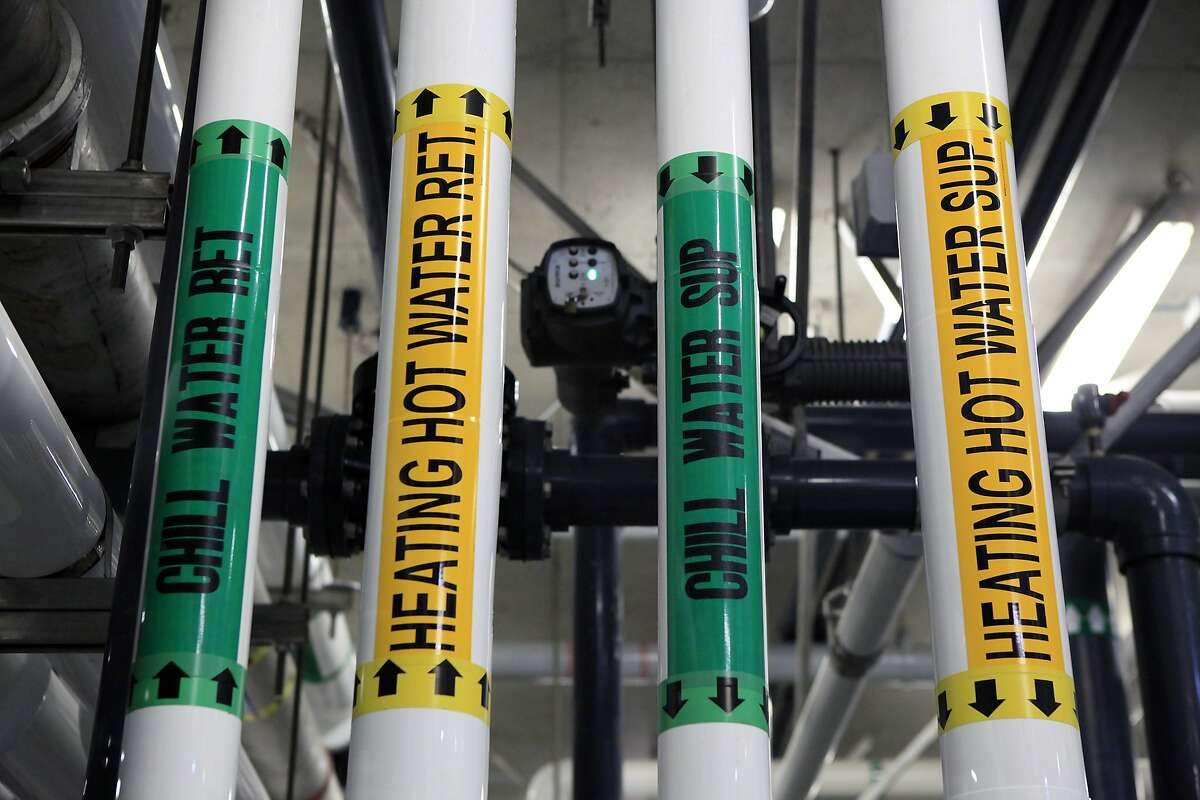 An array of pipes, pumps and filters are seen in the water filtration systems room underneath the California Academy of Sciences in San Francisco, CA, Tuesday, July 22, 2014.