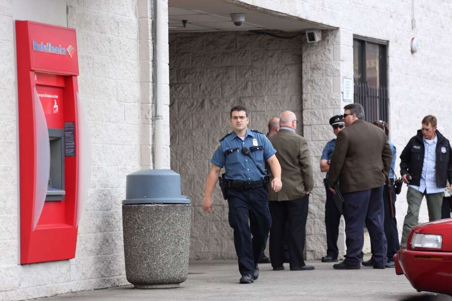 Officers work the scene after a security guard and another man were shot outside a Bank of America branch on Thursday, July 24, 2014. The shooting occurred near the intersection of 23rd Ave South and South Jackson Street. Photo: JOSHUA BESSEX, SEATTLEPI.COM