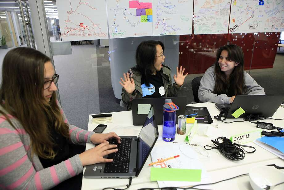 Anna Byrne-Deming (left) Lily Young and Camille Beltran attend a class offered by Girls Who Code, above, with teaching assistant Freia Lobo, below, at Square headquarters in San Francisco. Photo: Michael Short, The Chronicle