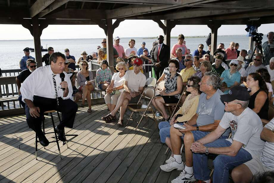 New Jersey Gov. Chris Christie (left) answers a pension question in Long Beach Township, N.J. Photo: Mel Evans, Associated Press
