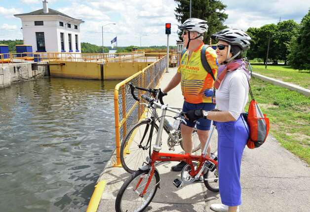 Dick Railsbach of Lincoln, Neb. left, and Cynthia Schultz of Arlington, Vt., take a break from their bike ride to admire the lock works at Lock 7, on the Mohawk River Thursday July 24, 2014, in Niskayuna, NY.  (John Carl D'Annibale / Times Union) Photo: John Carl D'Annibale / 00027922A